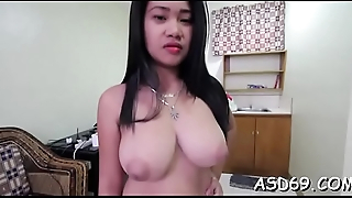 Nice thai girl squeezes her dude'_s 10-pounder and takes it in mouth